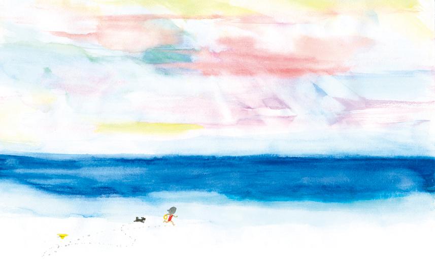 海辺を走る少女と小犬